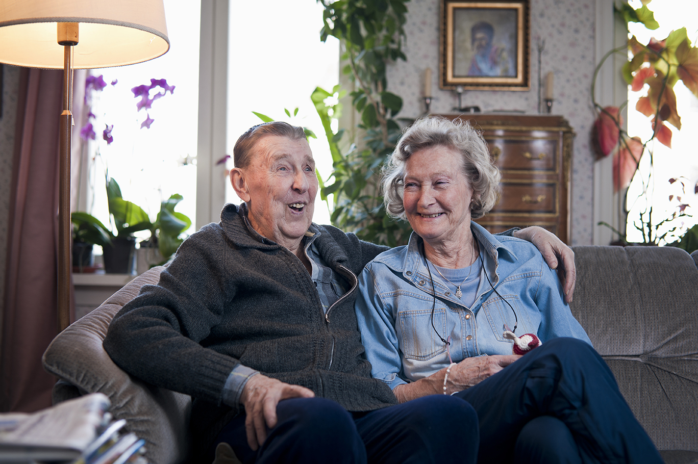 Older couple sitting together on sofa